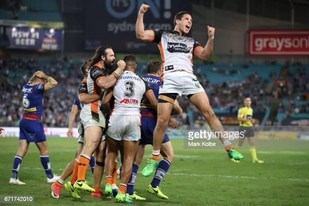 Aaron Woods Michael CheeKam and Mitch Moses of the Tigers celebrates victory with his team during the round eight NRL match between the Wests Tigers...