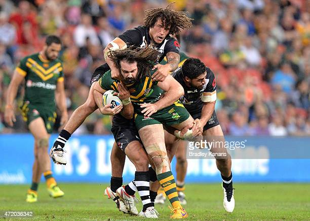 Aaron Woods of Australia is brought down by the Kiwi defence during the TransTasman Test match between the Australia Kangaroos and the New Zealand...