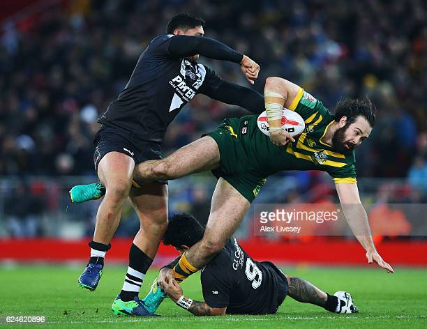 Aaron Woods of Australia is tackled by Jason Taumalolo and Issac Luke of New Zealand during the Four Nations Final between New Zealand and Australia...