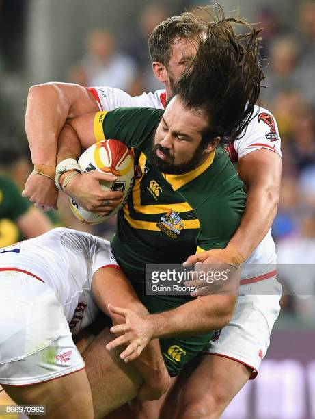 Aaron Woods of Australia is tackled during the 2017 Rugby League World Cup match between the Australian Kangaroos and England at AAMI Park on October...