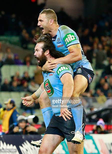 Aaron Woods of the Blues celebrates after scoring a try during game two of the State of Origin series between the New South Wales Blues and the...