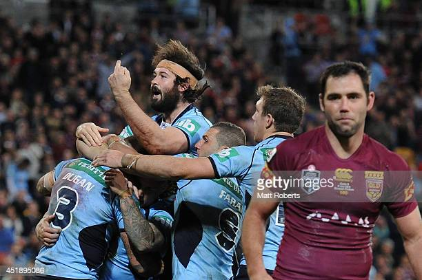 Aaron Woods of the Blues celebrates with team mates a try by Josh Dugan during game three of the State of Origin series between the Queensland...