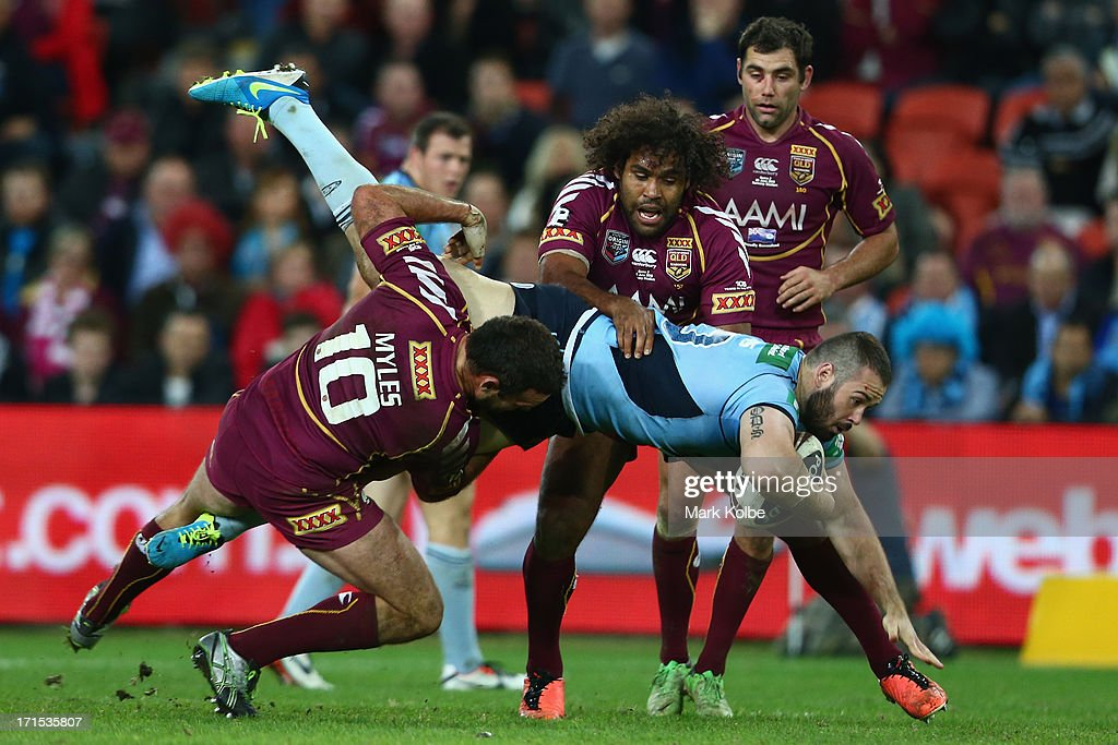 Aaron Woods of the Blues is tackled during game two of the ARL State of Origin series between the Queensland Maroons and the New South Wales Blues at Suncorp Stadium on June 26, 2013 in Brisbane, Australia.