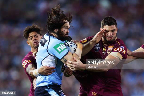 Aaron Woods of the Blues is tackled during game two of the State Of Origin series between the New South Wales Blues and the Queensland Maroons at ANZ...