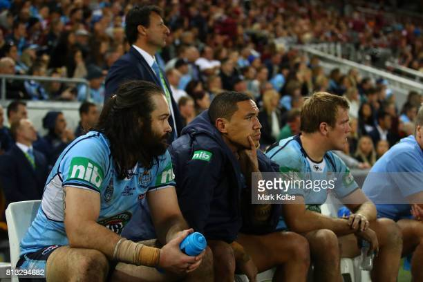 Aaron Woods of the Blues looks on from the bench during game three of the State Of Origin series between the Queensland Maroons and the New South...