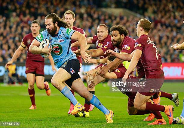 Aaron Woods of the Blues scores a try during game two of the State of Origin series between the New South Wales Blues and the Queensland Maroons at...