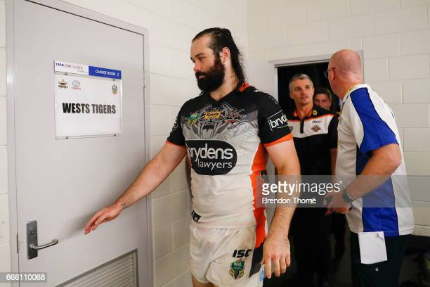 Aaron Woods of the Tigers and Ivan Cleary walk to the dressing room following a press conference during the round six NRL match between the North...