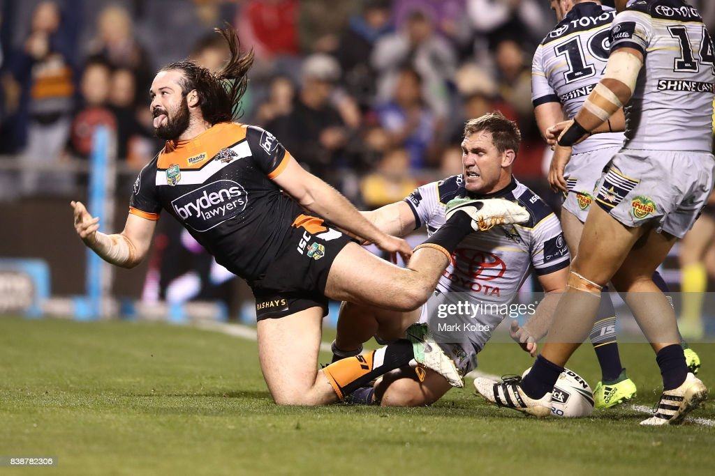 Aaron Woods of the Tigers celebrates scoring a try during the round 25 NRL match between the Wests Tigers and the North Queensland Cowboys at Campbelltown Sports Stadium on August 25, 2017 in Sydney, Australia.