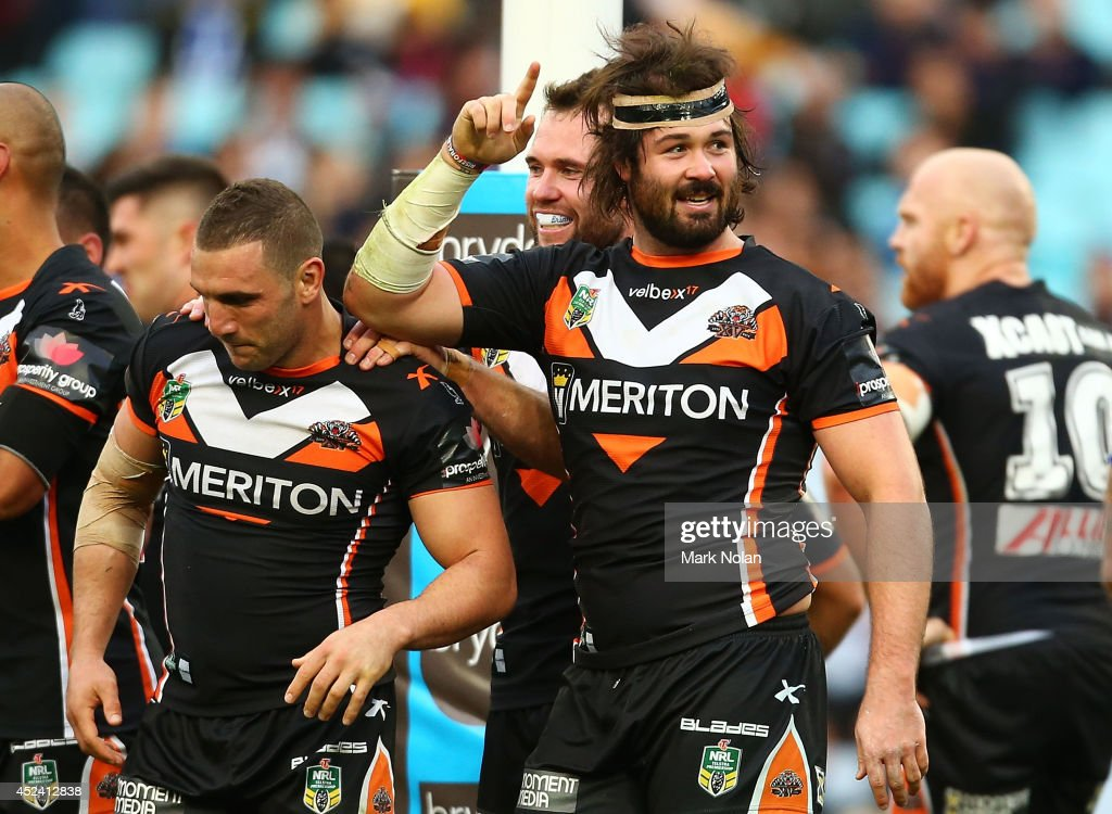 Aaron Woods of the Tigers celebrates scoring a try with team mates during the round 19 NRL match between the Wests Tigers and the Canterbury Bulldogs at ANZ Stadium on July 20, 2014 in Sydney, Australia.