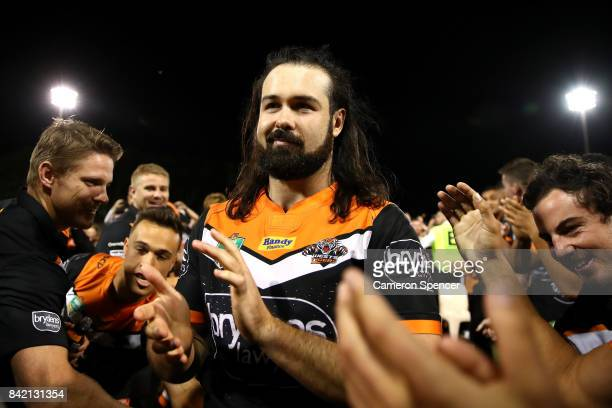 Aaron Woods of the Tigers is applauded as he leaves the field after playing his final game for the Tigers during the round 26 NRL match between the...