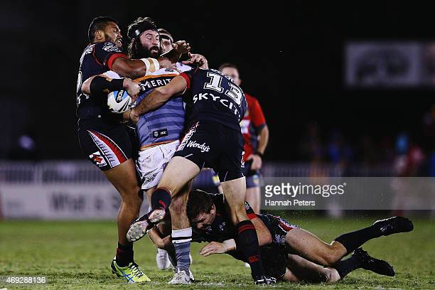 Aaron Woods of the Tigers is brought down during the round six NRL match between the New Zealand Warriors and the Wests Tigers at Mt Smart Stadium on...
