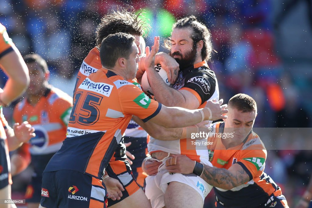 Aaron Woods of the Tigers is tackled during the round 17 NRL match between the Newcastle Knights and the Wests TIgers at McDonald Jones Stadium on July 2, 2017 in Newcastle, Australia.