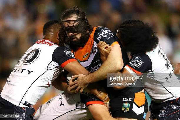 Aaron Woods of the Tigers is tackled during the round 26 NRL match between the Wests Tigers and the New Zealand Warriors at Leichhardt Oval on...