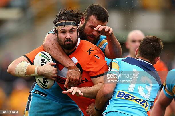 Aaron Woods of the Tigers is tackled during the round 8 NRL match between the Wests Tigers and the Gold Coast Titans at Leichhardt Oval on April 27...