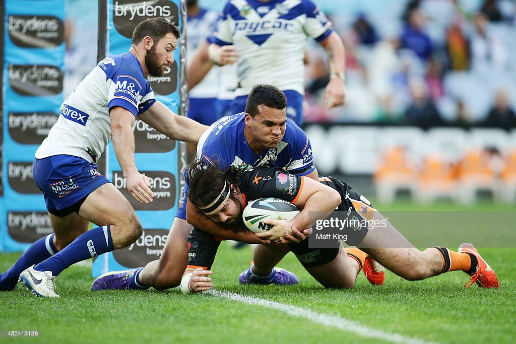 Aaron Woods of the Tigers scores a try during the round 19 NRL match between the Wests Tigers and the Canterbury Bulldogs at ANZ Stadium on July 20, 2014 in Sydney, Australia.