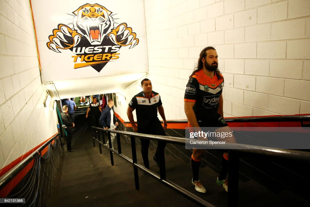 Aaron Woods of the Tigers walks up the players tunnel for the final time after playing his last game for the Tigers during the round 26 NRL match between the Wests Tigers and the New Zealand Warriors at Leichhardt Oval on September 3, 2017 in Sydney, Australia.