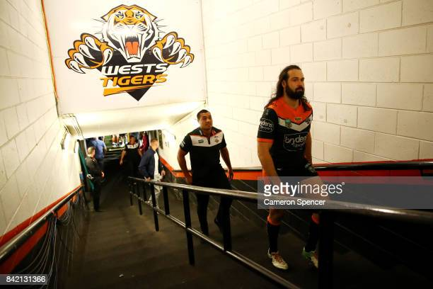 Aaron Woods of the Tigers walks up the players tunnel for the final time after playing his last game for the Tigers during the round 26 NRL match...