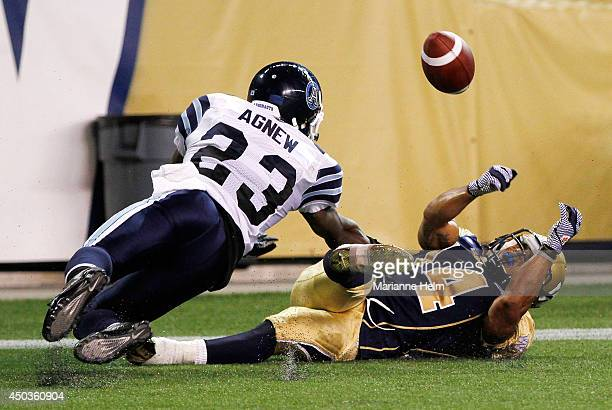 Aaron Woods of the Winnipeg Blue Bombers can't come up with the ball in the endzone as Vincent Agnew of the Toronto Argonauts defends in secondhalf...