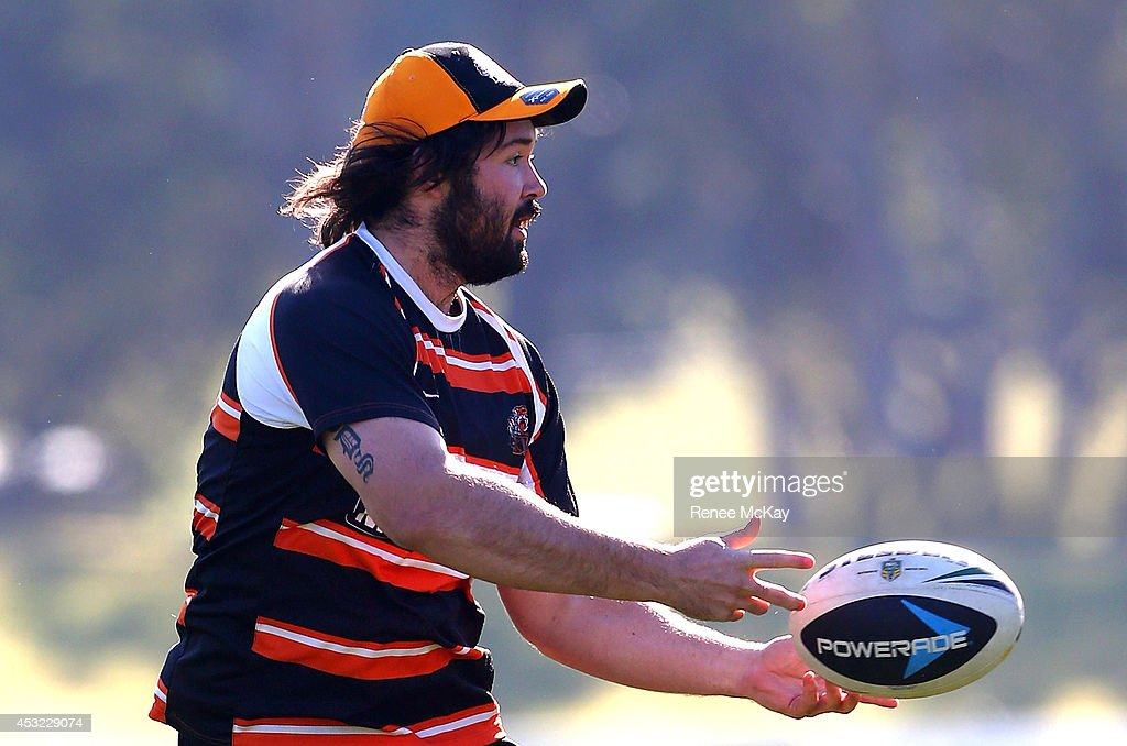 Aaron Woods passes the ball during a Wests Tigers NRL training session at Concord Oval on August 6, 2014 in Sydney, Australia.