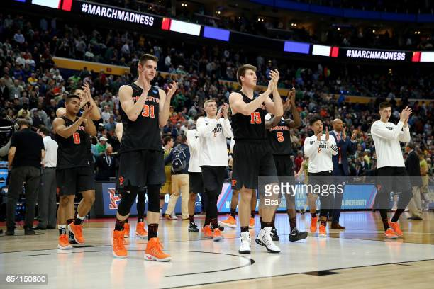 Aaron Young Pete Miller Will Gladson and of Amir Bell of the Princeton Tigers react after being defeated by the Notre Dame Fighting Irish with a...
