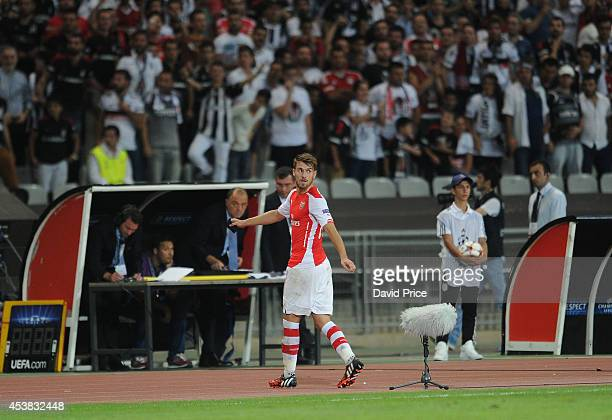 Aarson Ramsey of Arsenal looks back to the pitch after being sent off during the UEFA Champions League playoff first leg between Besiktas JK and...