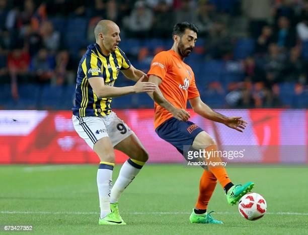 Aatif Chahechouhe of Fenerbahce vies for the ball against Mahmut Tekdemir of Medipol Basaksehir during the Ziraat Turkish Cup semi final soccer match...
