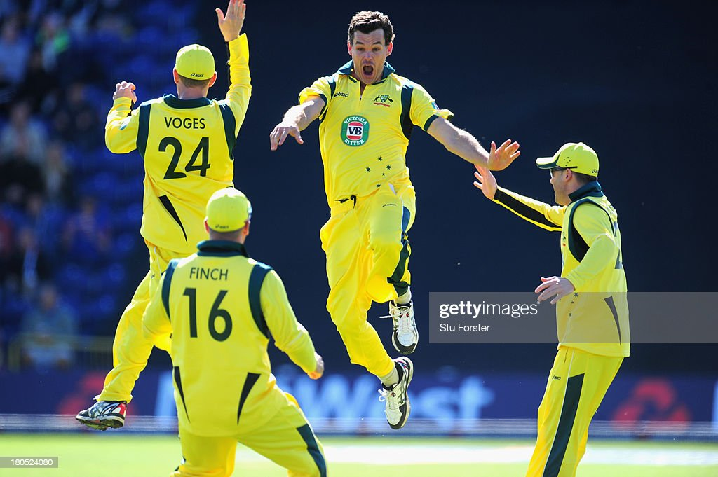 Aaustralia bowler Clint Mckay (c) celebrates after completing his hatrick by dismissing England batsman Joe Root during the 4th NatWest Series ODI between England and Australia at SWALEC Stadium on September 14, 2013 in Cardiff, Wales.