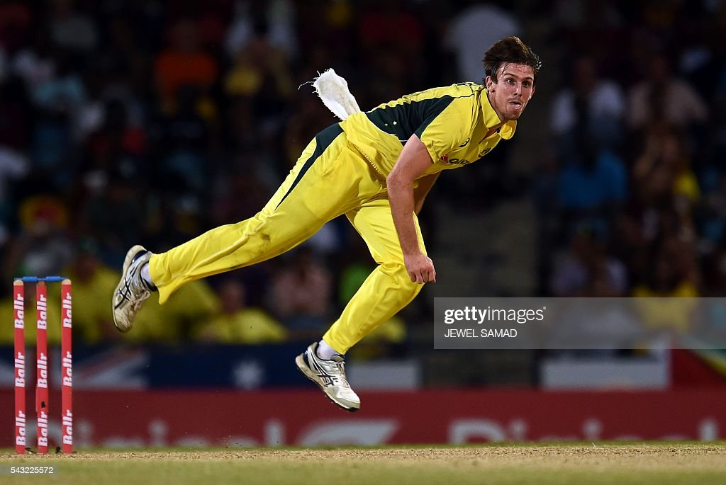 AAustralian cricketer Mitchell Marsh delivers a ball during the final match of the Tri-nation Series between Australia and West Indies in Bridgetown on June 26, 2016. / AFP / Jewel SAMAD