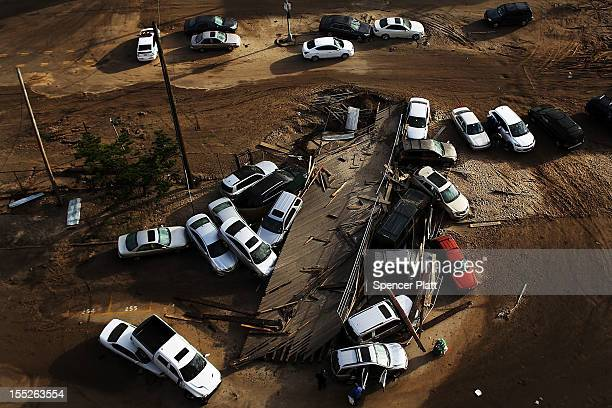 Abandoned and flooded cars are viewed in the heavily damaged Rockaway neighborhood in Queens where a large section of the iconic boardwalk was washed...