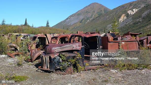 Abandoned army trucks on the Canol Trail