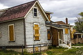 Abandoned Home With Boarded Up Windows