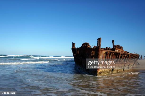 Abandoned Boat In Sea Against Clear Sky