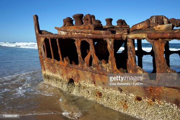 Abandoned Boat On Sea Against Clear Sky