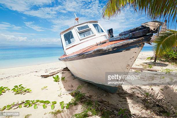 Abandoned Boat on Tropical Island