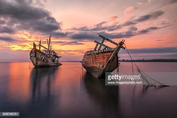 Abandoned Boats at Sunrise
