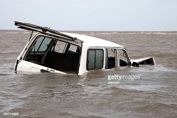 Abandoned bogged flooded and submerged car in sea water
