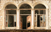 Abandoned building featuring arched windows