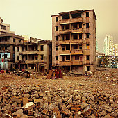 Abandoned buildings and rubble with modern high-rise buildings in background, Shenzhen, China