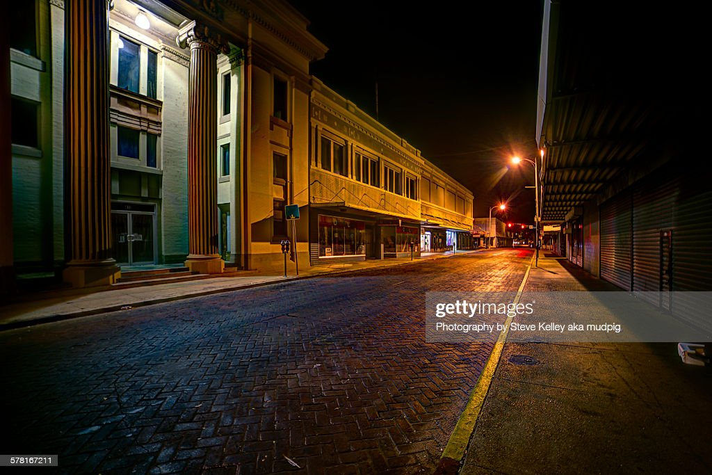 Abandoned business district at night