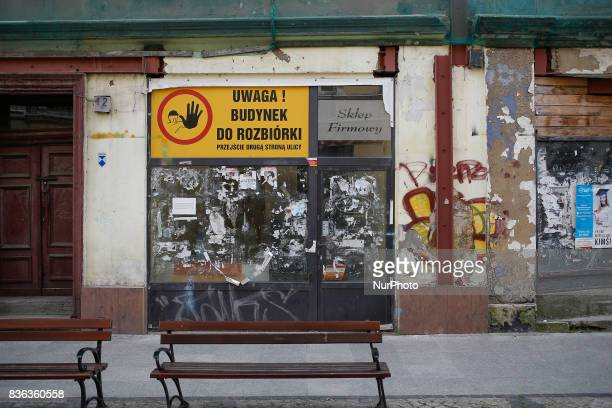 Abandoned business spaces are seen on the Dluga shopping street in the center of the old city on 20 August 2017