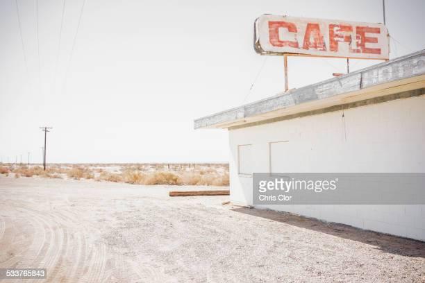 Abandoned cafe on rural dirt road