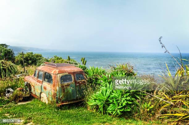 Abandoned car and coastline of South Island,New Zealand.
