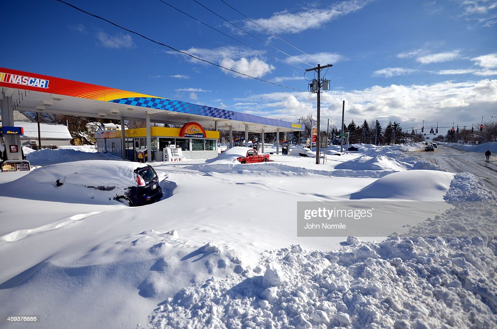 Abandoned cars wait to recovered at gas station on November 20 2014 in the suburb of Blasdell Buffalo New York The record setting Lake effect...