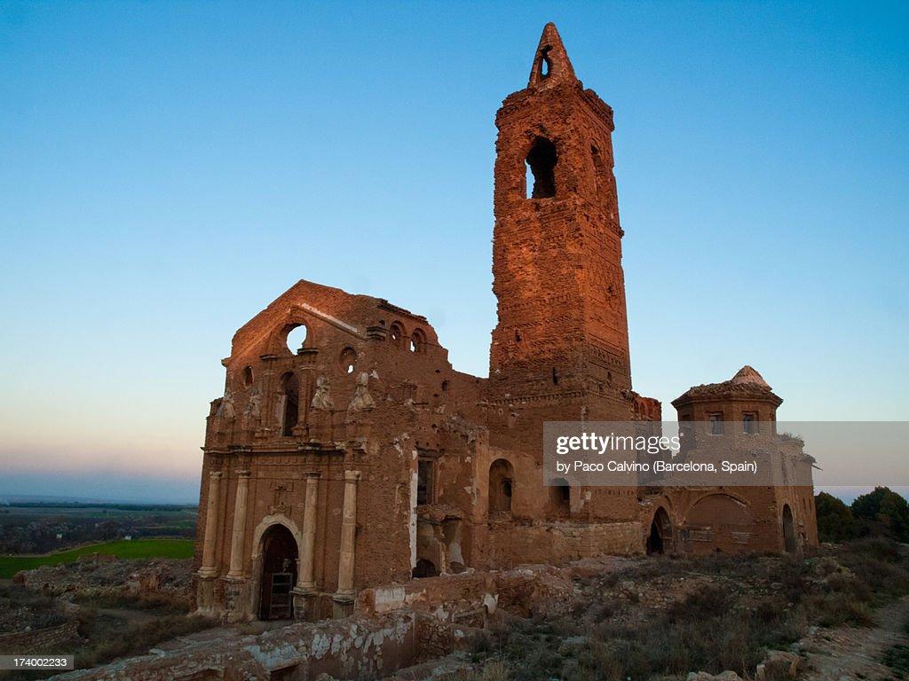 Abandoned catholic church at sunset