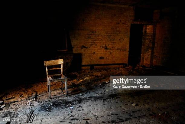 Abandoned Chair In Room
