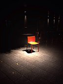 Abandoned Chair In Spot Lit