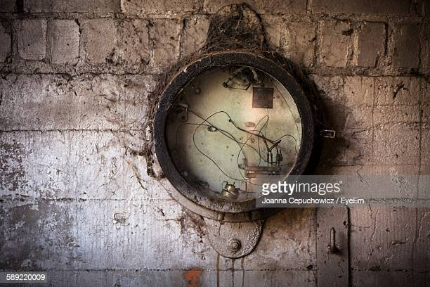 Abandoned Clock On Wall At Old Factory