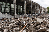 Abandoned destroyed factory building, industrial background
