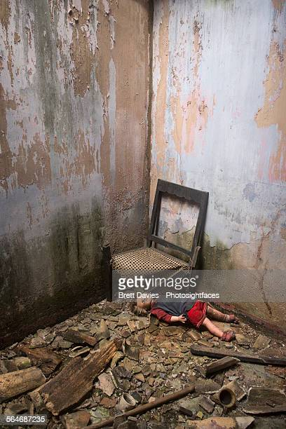 Abandoned doll by chair