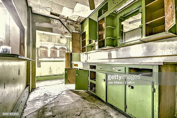 Abandoned Domestic Kitchen With Cabinets